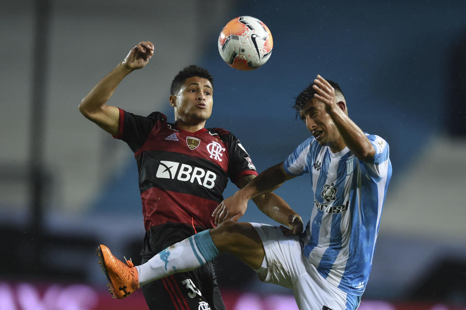 Argentina's Racing Club Alexis Soto (R) and Brazil's Flamengo Joao Gomes jump for the ball during their closed-door Copa Libertadores round before the quarterfinals football match at the Presidente Peron stadium in Avellaneda, Buenos Aires Province, Argentina, on November 24, 2020. (Photo by Marcelo Endelli / POOL / AFP) (Photo by MARCELO ENDELLI/POOL/AFP via Getty Images)