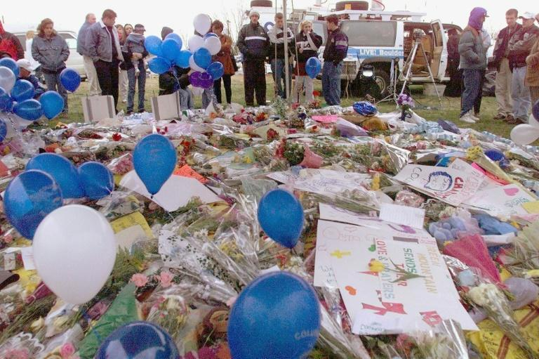 Littleton, Colorado residents mourn the 13 people killed by two heavily armed students at Columbine High School on April 20, 1999
