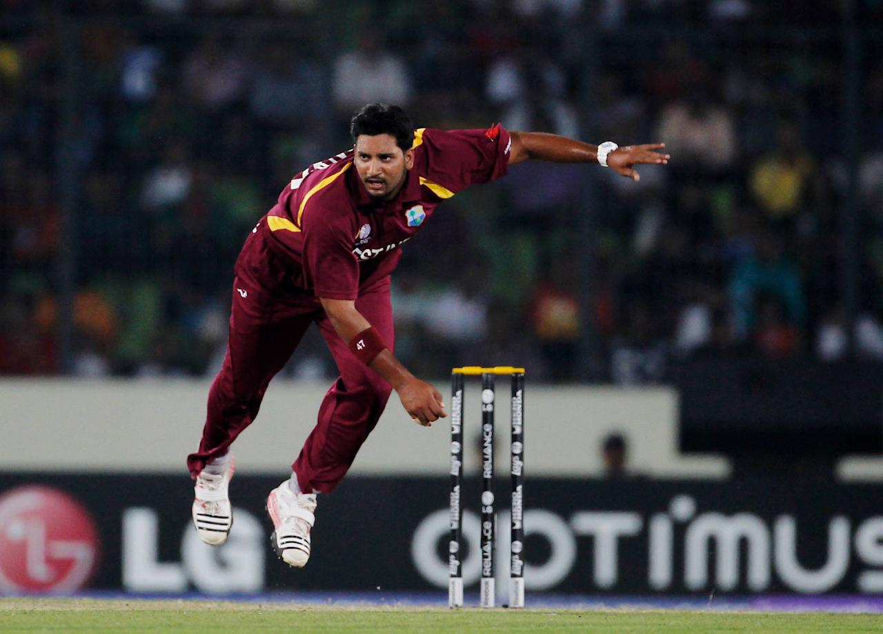 DHAKA, BANGLADESH - MARCH 23:  Ravi Rampaul of West Indies bowls during the first quarter-final match of the ICC Cricket World Cup between Pakistan and West Indies at Shere-e-Bangla National Stadium on March 23, 2011 in Dhaka, Bangladesh.  (Photo by Daniel Berehulak/Getty Images)