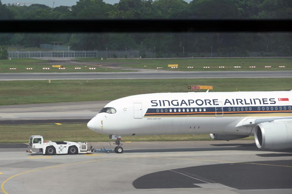 Singapore Airlines passenger plane is towed to the terminal area of Changi International Airport in Singapore on December 7, 2020. (Photo by Roslan RAHMAN / AFP) (Photo by ROSLAN RAHMAN/AFP via Getty Images)