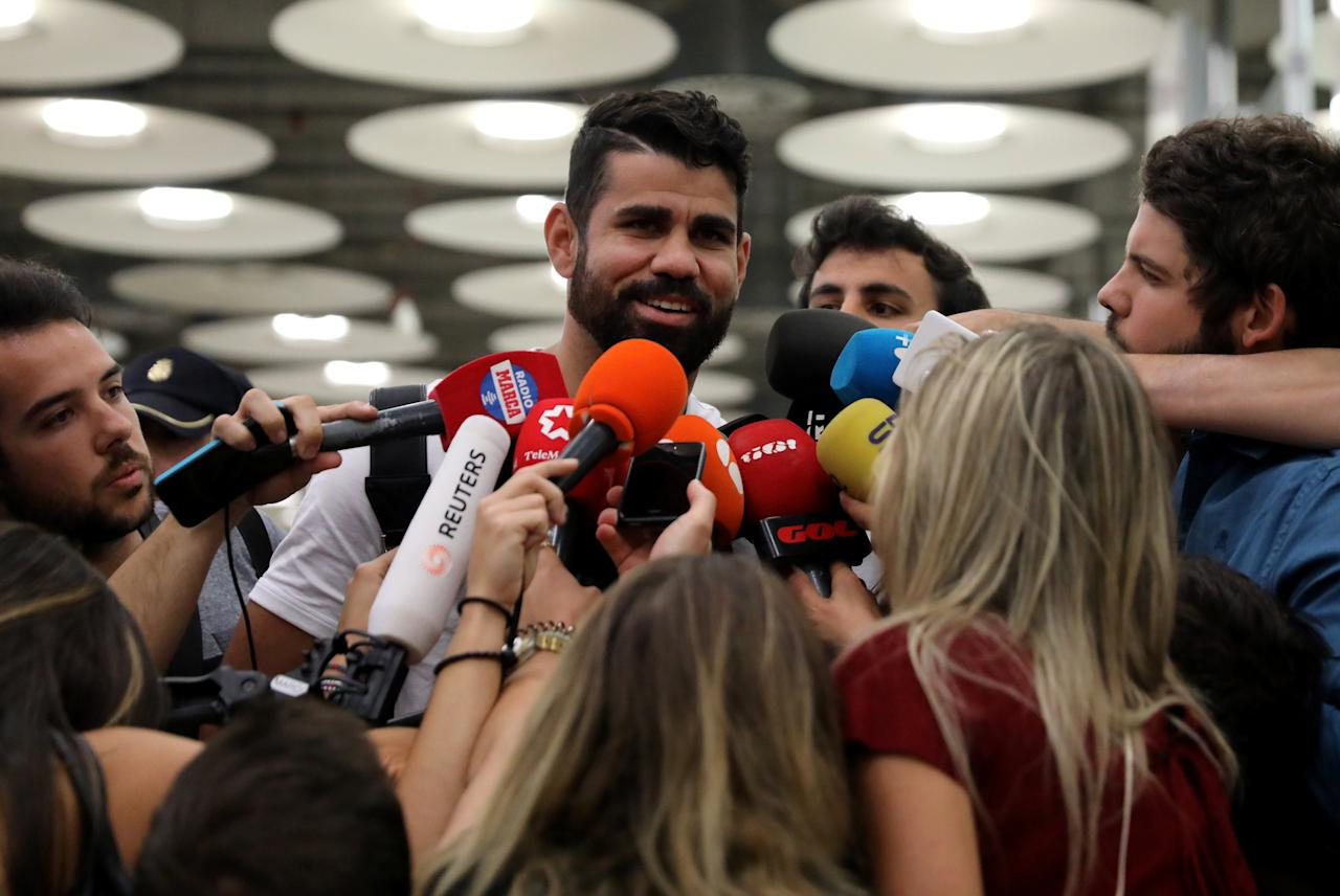 Spain's soccer player Diego Costa speaks to media upon arriving at Adolfo Suarez Madrid Barajas airport in Madrid, Spain, September 22, 2017. REUTERS/Sergio Perez