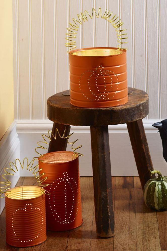 """<p>To make these festive pumpkin lights, simply draw a pumpkin design on a metal can with permanent marker, then fill the can with water and freeze. After, use a nail and a hammer to poke holes every ¼-inch to ½-inch along the design. Poke a hole on either side at the top for a handle. Once the water has melted and the can is dry, apply orange spray paint and let dry. Finally, cut a 24-inch piece of wire and coil around the marker, stretch it out, and hook it into the holes on the sides.</p><p><a class=""""link rapid-noclick-resp"""" href=""""https://www.amazon.com/Rust-Oleum-1954830-1954-830-11-Ounce-Orange/dp/B000ZYTZHK?tag=syn-yahoo-20&ascsubtag=%5Bartid%7C10070.g.2488%5Bsrc%7Cyahoo-us"""" rel=""""nofollow noopener"""" target=""""_blank"""" data-ylk=""""slk:SHOP ORANGE SPRAY PAINT"""">SHOP ORANGE SPRAY PAINT</a></p>"""