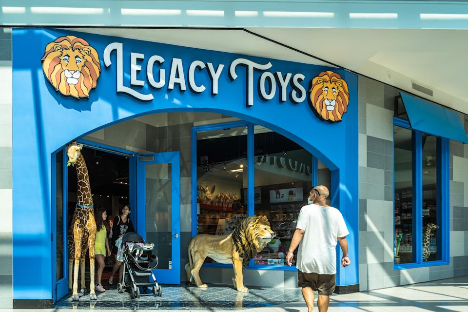 """A shopper exits the Legacy Toys store at the Mall of America on June 16, 2020 in Bloomington, Minnesota. - The US economy continues to bleed fresh jobs in the aftermath of COVID-19 shutdowns, even as it reopens and as the Paycheck Protection Program (PPP) and other federal initiatives mitigate some of the downturn's harshest impacts. Legacy Toys has used its PPP loan to build out an e-commerce business from its seven stores in Minnesota and North Dakota that now see """"skyrocketing"""" demand for curbside pickup from reopened stores, said owner Brad Ruoho. But Legacy, which obtained a $160,000 PPP loan, still has only rehired 35 of 75 staff members. The malls are operating at reduced hours, which means the stores require fewer workers, Ruoho said. (Photo by Kerem Yucel / AFP) (Photo by KEREM YUCEL/AFP via Getty Images)"""