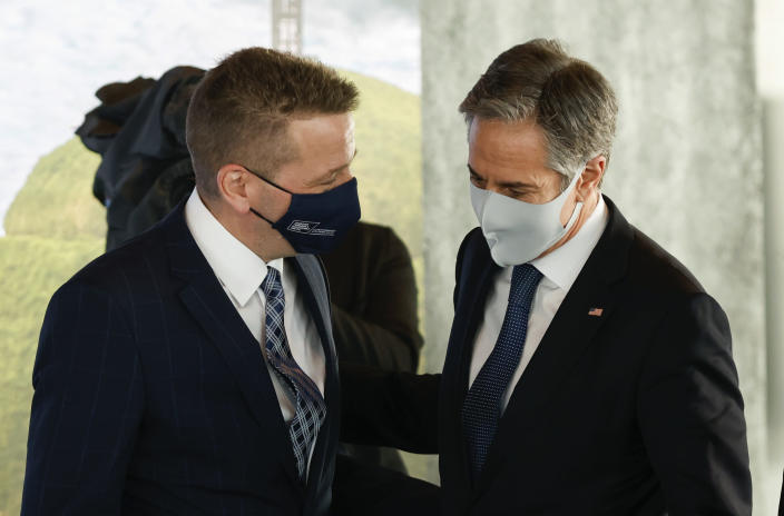 US Secretary of State Antony Blinken, right is greeted by Icelandic Minister of Foreign Affairs Gudlaugur Thor Thordarson as he arrives for the Arctic Council Ministerial Meeting in Reykjavik, Iceland, Thursday, May 20, 2021. Top diplomats from the United States and Russia sparred politely in Iceland during their first face-to-face encounter, which came as ties between the nations have deteriorated sharply in recent months. (AP Photo/Brynjar Gunnarsson, Pool)
