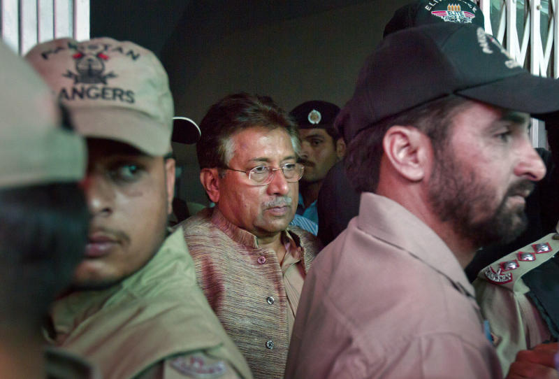 Paramilitary troops stand guard as Pakistan's former President and military ruler Pervez Musharraf, center, leaves after appearing in an anti-terrorism court in Islamabad, Pakistan on Saturday, April 20, 2013. The general who ruled Pakistan for nearly a decade before being forced to step down appeared Saturday in front of an anti-terrorism court in connection with charges linked to his 2007 sacking and detention of a number of judges. (AP Photo/Anjum Naveed)