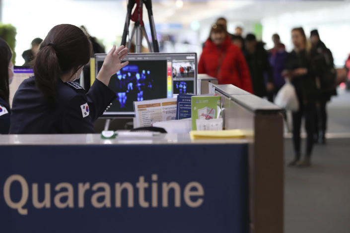 A thermal camera monitor shows the body temperature of passengers arriving from overseas at Incheon International Airport in Incheon, South Korea, Tuesday, Jan. 21, 2020. Heightened precautions were being taken in China and elsewhere Tuesday as governments strove to control the outbreak of a novel coronavirus that threatens to grow during the Lunar New Year travel rush. (Suh Myung-geon/Yonhap via AP)