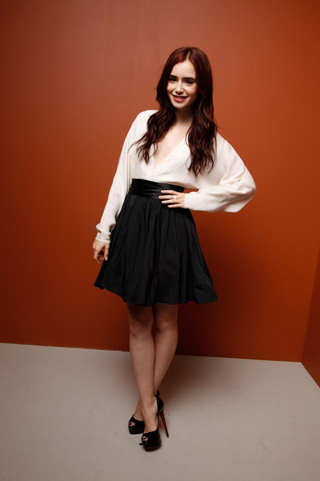 """TORONTO, ON - SEPTEMBER 09:  Actress Lily Collins of """"Writers"""" poses at the Guess Portrait Studio during 2012 Toronto International Film Festival on September 9, 2012 in Toronto, Canada.  (Photo by Matt Carr/Getty Images)"""