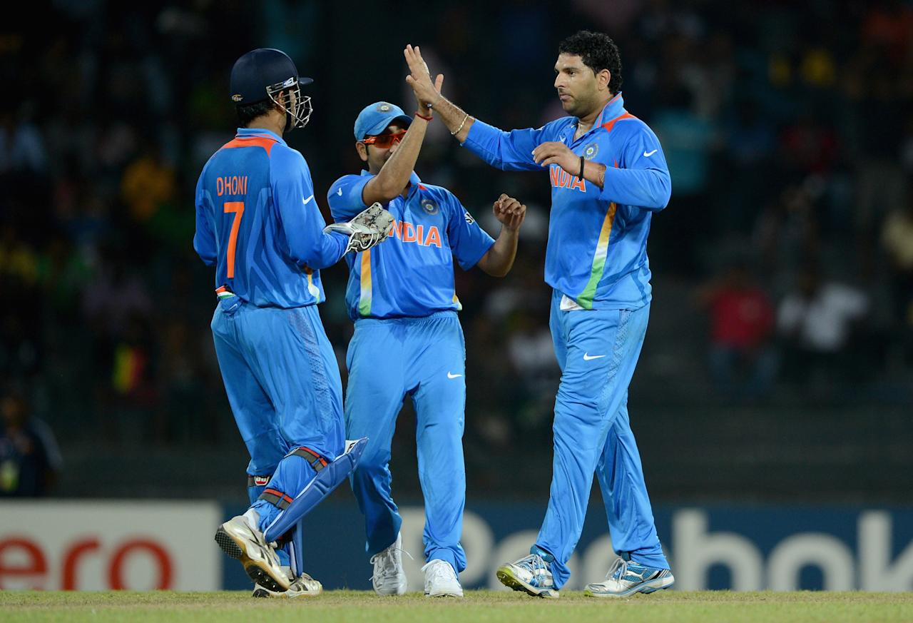 COLOMBO, SRI LANKA - SEPTEMBER 19:  Yuvraj Singh of India celebrates with teammates after dismissing Asghar Stanikzai of Afghanistan during the  ICC World Twenty20 2012: Group A match between India and Afghanistan at R. Premadasa Stadium on September 19, 2012 in Colombo, Sri Lanka.  (Photo by Gareth Copley/Getty Images,)