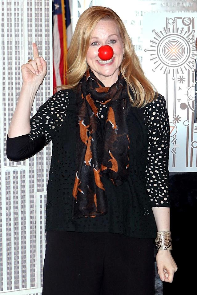 <p><em>Love Actually</em> actress Laura Linney rocked (what else?) a red nose while helping to light up the Empire State Building in honor of Red Nose Day. (Photo: BackGrid) </p>