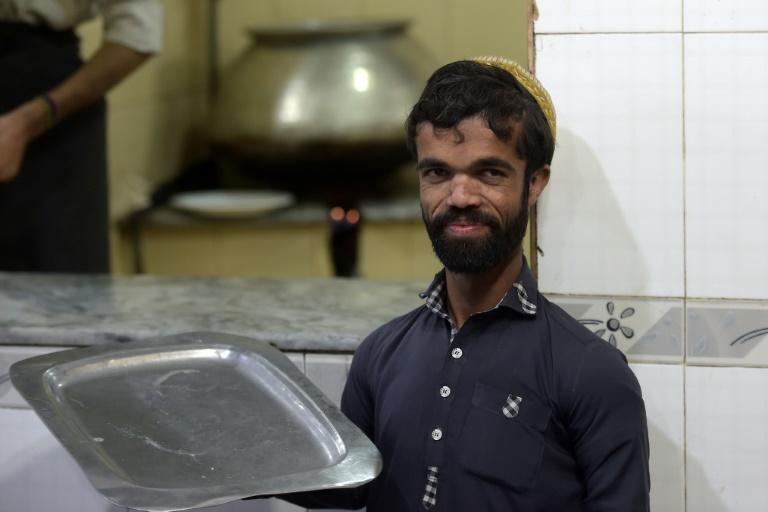 Khan works at a small Kashmiri restaurant down a narrow line in Rawalpindi