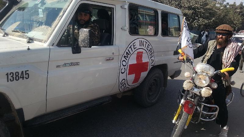 Taliban fighters are seen in an International Committee of the Red Cross (ICRC) vehicle a day after the insurgents overran the strategic northern city of Kunduz, on September 29, 2015 (AFP Photo/)