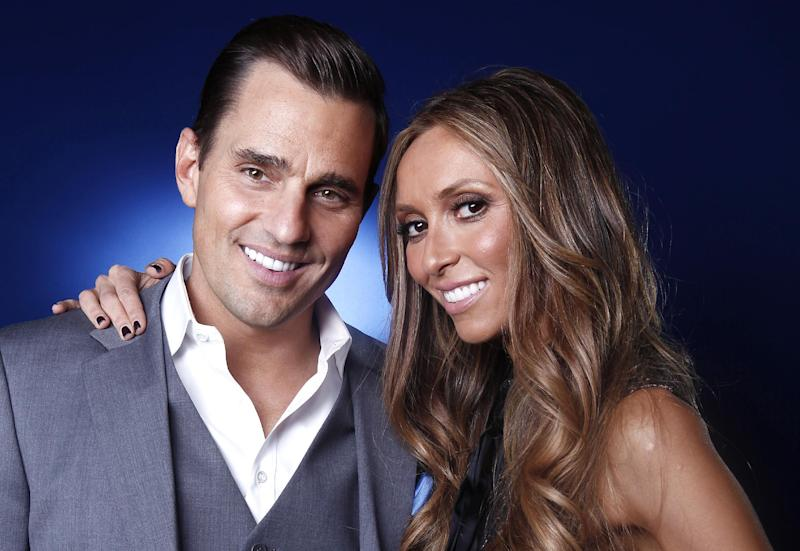 "FILE - This April 2, 2012 file photo shows TV personality and businessman Bill Rancic in New York. Rancic embraces the notion of being part of a power couple with wife Giuliana. Together they have a reality show ""Giuliana & Bill"" on the Style Network and are in the restaurant business. (AP Photo/Carlo Allegri, File)"