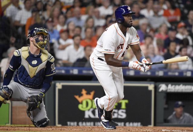 Houston Astros designated hitter Yordan Alvarez, right, watches his two-run home run off Milwaukee Brewers relief pitcher Matt Albers during the fifth inning of a baseball game, Tuesday, June 11, 2019, in Houston. (AP Photo/Eric Christian Smith)