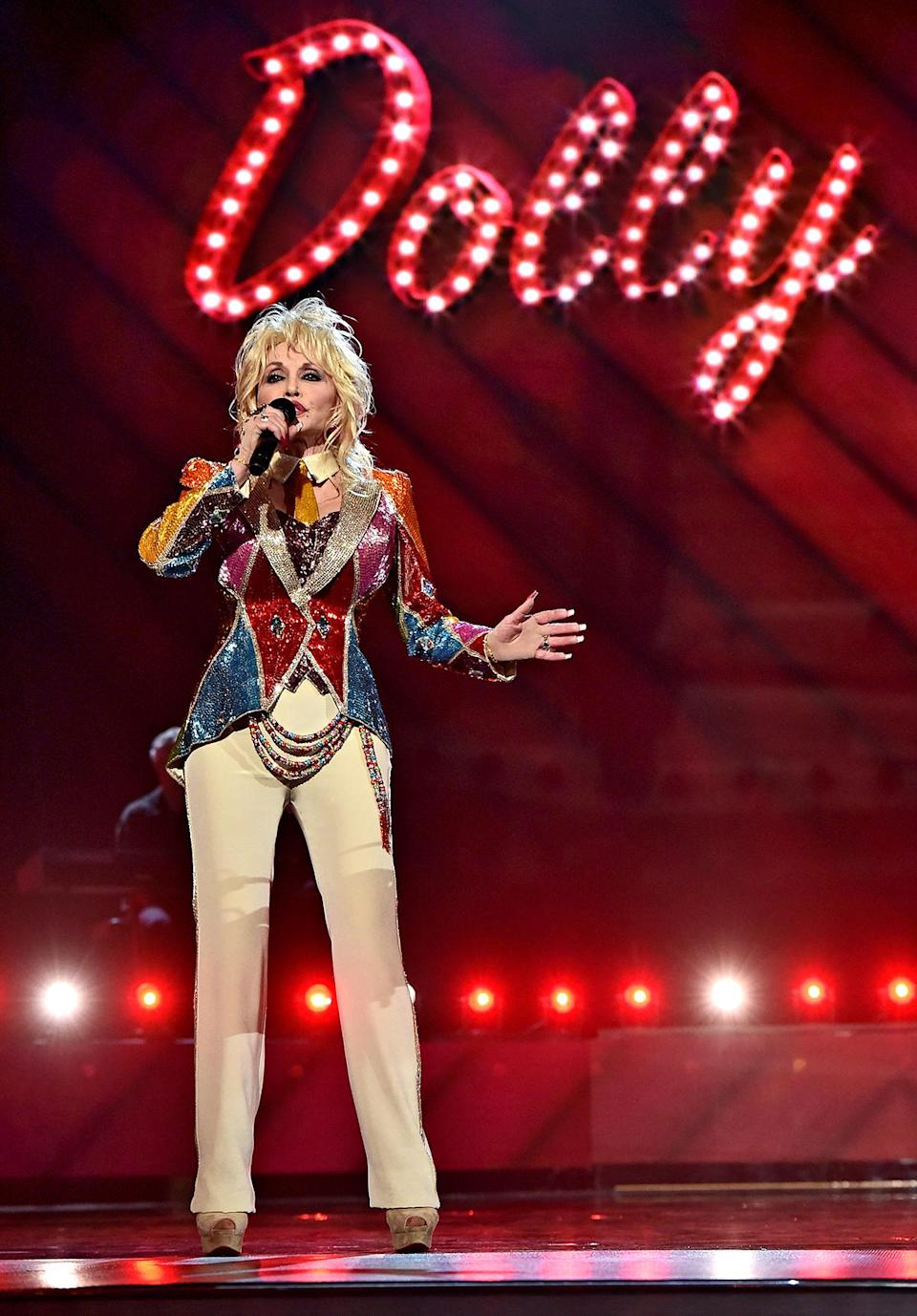 """<p>""""I'm old-school,"""" Parton has said. """"If you're going onstage, you should look like a star!"""" She wore a modern """"Coat of Many Colors"""" to the ACMs in 2016.</p>"""