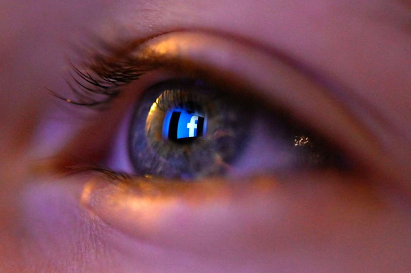 This illustration picture, taken on January 12, 2020 shows Facebook social network logo reflected on a eye in Rennes, western France: AFP via Getty