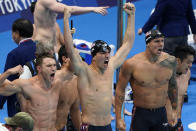 Caeleb Dressel, of United States, right, and teammates celebrate winning the gold medal in the men's 4x100-meter medley relay final at the 2020 Summer Olympics, Sunday, Aug. 1, 2021, in Tokyo, Japan. (AP Photo/Jae C. Hong)