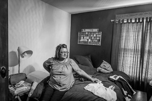 Beth Genslinger mourns the death of her son Andy, who died from a heroin overdose in his bedroom in Germantown, Ohio. She sits on his bed where she found him dead. (Photograph by Mary F. Calvert for Yahoo News)