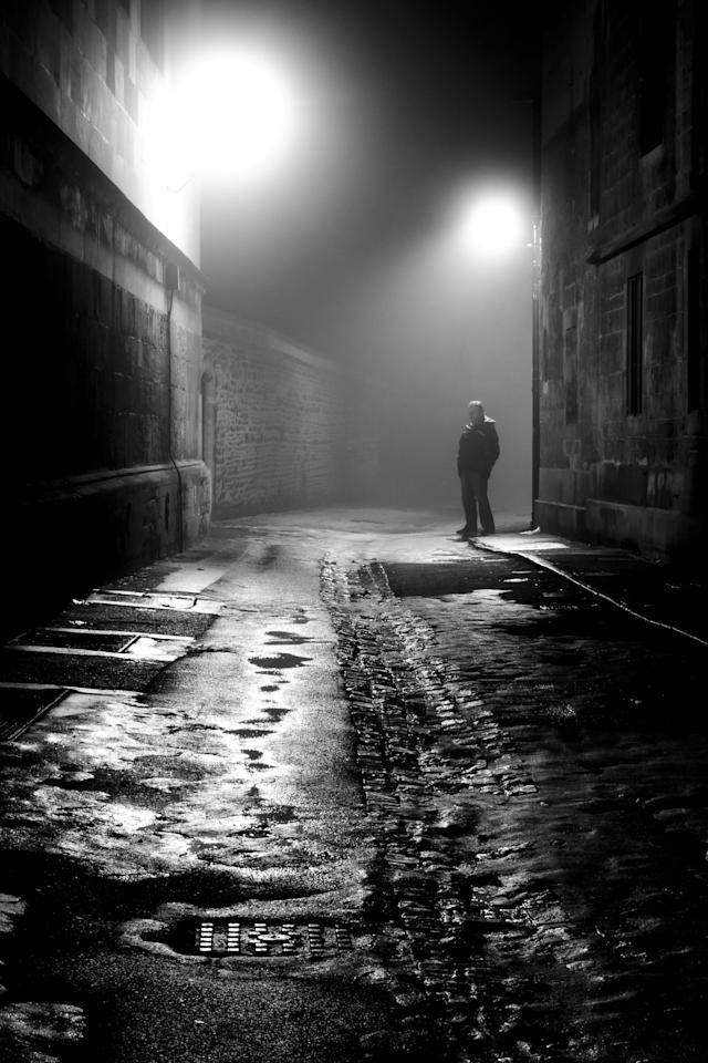 Man in the Fog by Stephen Colbrook, Oxford, England (Overall Young Photographer of the Year Winner): Stephen said his photo helped draw the viewer in throughn the 'diagonal lines of the buildings, combined with the focal point of the lone and distant man'.
