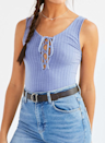 "<p>The lace-up top is daring, stylish and perfect for layering however you want. You can adjust the bust by tightening or loosening the strings. Undo the front bow and let the strings hang for a more laid-back vibe. </p><p><i>Project Social T Lace-Up Ribbed Tank Top, $25, <a href=""http://www.urbanoutfitters.com/ca/en/catalog/productdetail.jsp?id=37479730&color=004&cm_mmc=SEM-_-Google-_-PLA-_-82529881024product_type_l1w%26product_type_l2app%26product_type_l3camis&adpos=1o1&creative=98640307738&device=c&matchtype=&network=g&gclid=Cj0KEQjwx96-BRDyzY3GqcqZgcgBEiQANHd-nvDLQ87dSBrfccmY_GXKx40m7pNQszCmsr5RwtrBePsaApYT8P8HAQ"" rel=""nofollow noopener"" target=""_blank"" data-ylk=""slk:urbanoutfitters.com"" class=""link rapid-noclick-resp"">urbanoutfitters.com</a></i></p>"