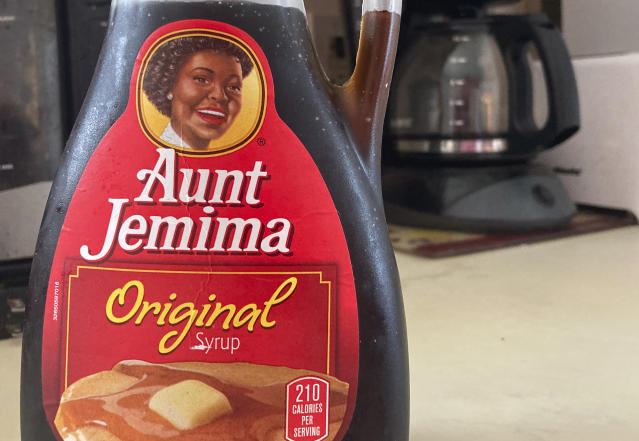 A bottle of Aunt Jemima syrup sits on a counter, Wednesday, June 17, 2020 in White Plains, N.Y. Pepsico is changing the name and marketing image of its Aunt Jemima pancake mix and syrup, according to media reports. A spokeswoman for Pepsico-owned Quaker Oats Company told AdWeek that it recognized Aunt Jemima's origins are based on a racial stereotype and that the 131-year-old name and image would be replaced on products and advertising by the fourth quarter of 2020. (AP Photo/Donald King)