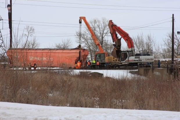 Crews work to move a train car that derailed in Calgary on Sunday.