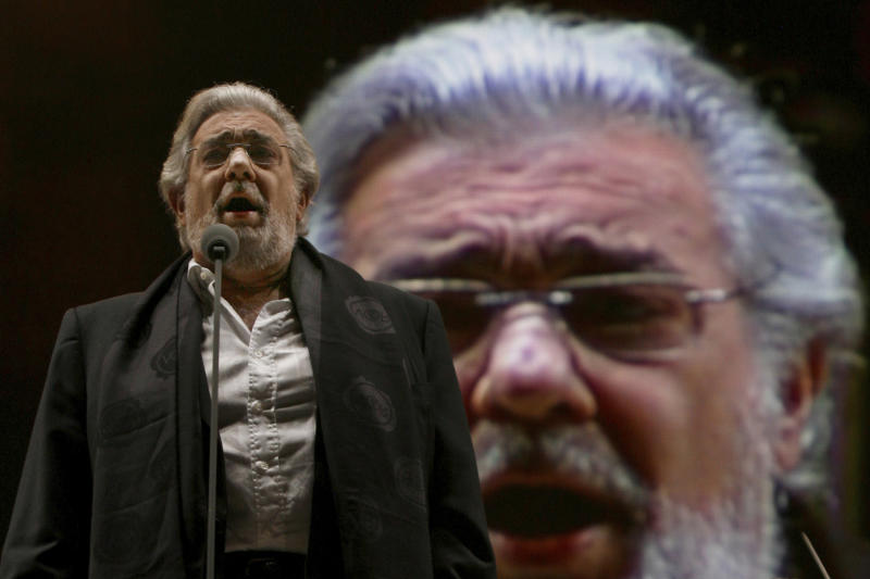 FILE - In this Saturday, Dec. 19, 2009 file photo, Placido Domingo performs during a sound check prior to a free concert in Mexico City. Two investigations into Domingo's behavior were opened in 2019 after Associated Press stories in which more than 20 women said the legendary tenor had pressured them into sexual relationships, behaved inappropriately and sometimes professionally punished those who rebuffed him. Dozens of others told the AP that they had witnessed his behavior. (AP Photo/Marco Ugarte)