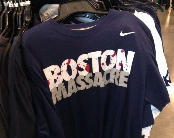 "This undaeted  photo provided by Eric Stangel shows a Nike shirt for sale at a Nike Outlet. Nike Inc. announced Monday, April 22, 2013, it has pulled from the market T-shirts emblazoned with the words ""Boston Massacre"" in the aftermath of last week's bombing during the Boston Marathon that killed three people and left dozens injured. The ""Boston Massacre"" phrase has been used to describe a pivotal late-season sweep by the Yankees of the rival Boston Red Sox in 1978. That season culminated in a World Series championship for the Yankees. (AP Photo/Eric Stangel)"
