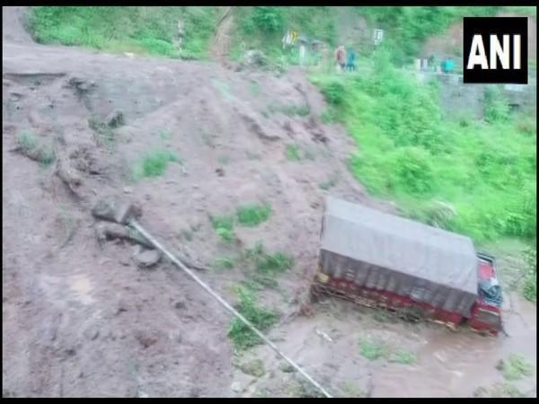 A car and truck fell into a gorge due to flash floods in the Belkhet area of Uttarakhand's Champawat on Tuesday. [Photo/ANI]