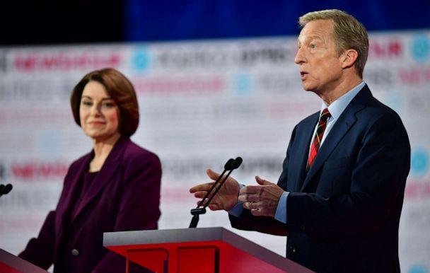 PHOTO: Amy Klobuchar listens to Tom Steyer speak on stage during the sixth Democratic primary debate of the 2020 presidential campaign season co-hosted by PBS NewsHour & Politico at Loyola Marymount University in Los Angeles, California. (Frederic J. Brown/AFP via Getty Images)