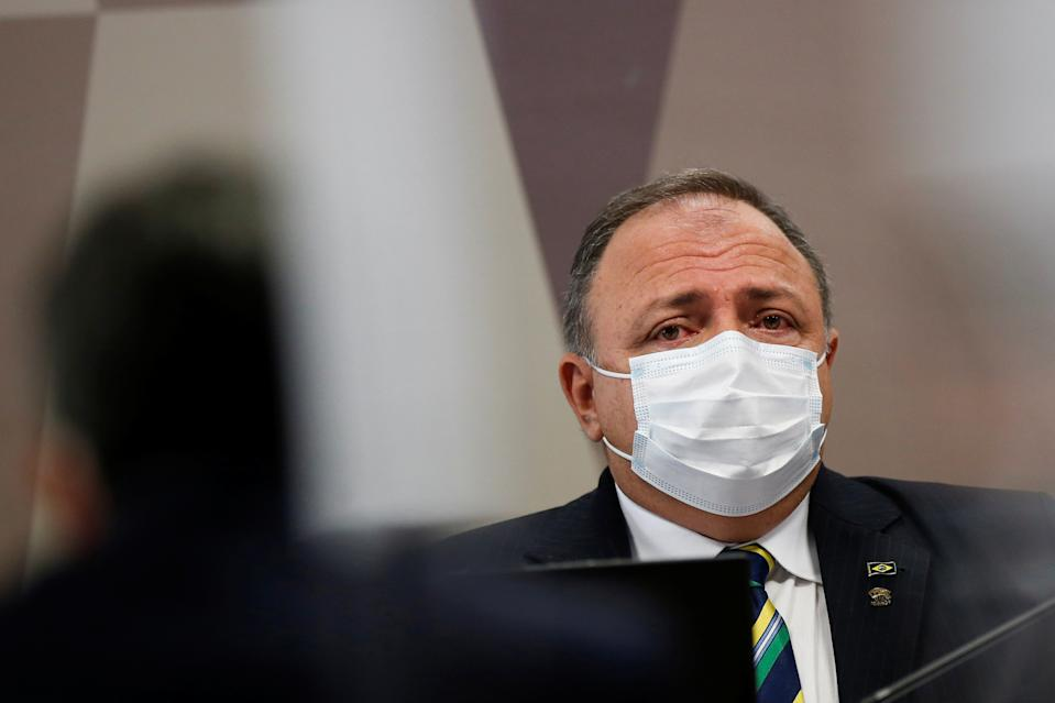 Former Brazil's Health Minister Eduardo Pazuello attends a meeting of the Parliamentary Inquiry Committee (CPI) to investigate government actions and management during the coronavirus disease (COVID-19) pandemic, at the Federal Senate in Brasilia, Brazil May 19, 2021. REUTERS/Adriano Machado