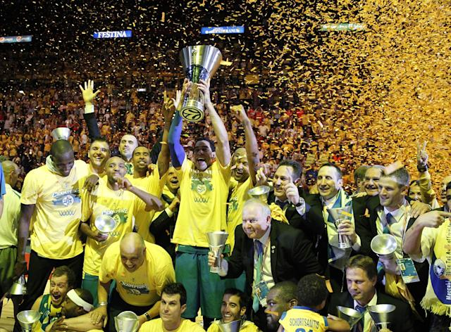 Maccabi of Tel Aviv captain Maccabi Guy Pnini holds the trophy and celebrate with teammates after winning the Euroleague Final Four final against Real Madrid in Milan, Italy, Sunday, May 18, 2014. Maccabi won 98-86. (AP Photo/Luca Bruno)