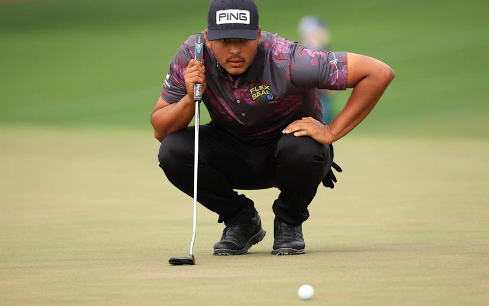 Sebastian Munoz of Colombia lines up a putt on the second green during the third round of the Masters at Augusta National Golf Club - Getty Images