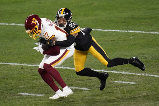 Washington Football Team wide receiver Terry McLaurin (17) is tackled by Pittsburgh Steelers cornerback Joe Haden (23) after making a catch during the first half of an NFL football game, Monday, Dec. 7, 2020, in Pittsburgh. (AP Photo/Keith Srakocic)