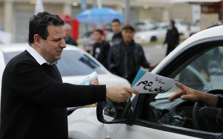 Leading Israeli Arab politician Ayman Odeh hands out leaflets while campaigning for Tuesday's general election
