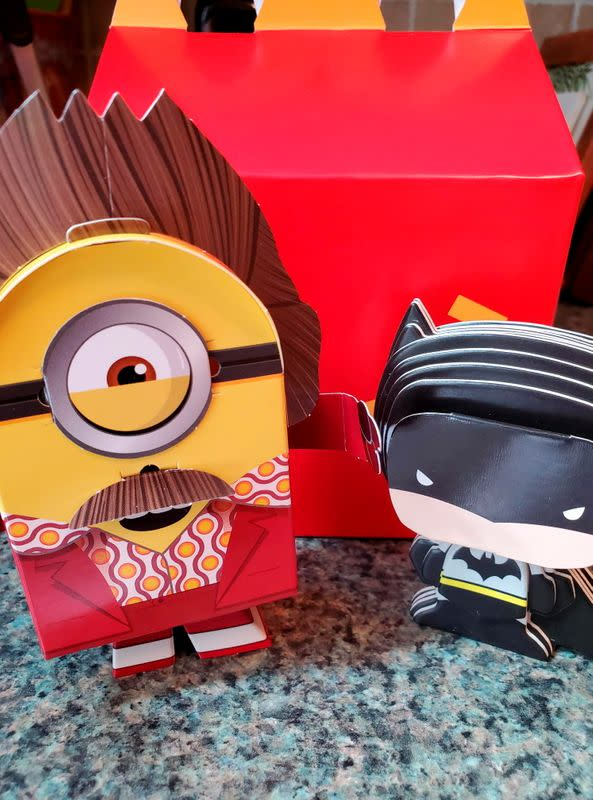 Batman and Minions toys made from paper and cardboard that children assemble themselves are seen in New York