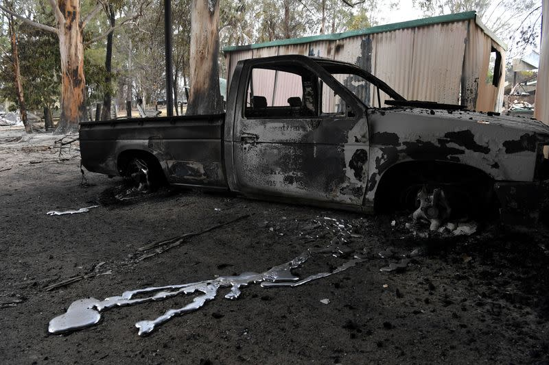 A burnt out vehicle is seen at a destroyed property in Sarsfield in East Gippsland