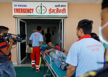 Syangboche Karki, a victim of a small aircraft belonging to Summit Air, that crashed with a helicopter parked at Lukla airport, is brought for treatment to a hospital in Kathmandu, Nepal April 14, 2019. REUTERS/Navesh Chitrakar