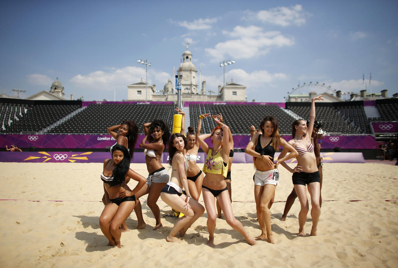 Dancers rehearse their performances for the London 2012 Olympic beach volleyball matches at the main court at the Horse Guards Parade in London July 25, 2012. REUTERS/Marcelo del Pozo (BRITAIN - Tags: SPORT OLYMPICS VOLLEYBALL)
