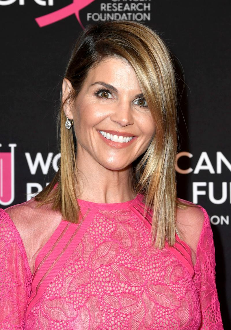 FILE - MARCH 12: According to documents released March 12, 2019 actresses Lori Loughlin and Felicity Huffman are among 50 people charged in a college entrance exam cheating ploy. The ploy involved attempting to get potential students recruited as athletes and helping them cheat on exams. BEVERLY HILLS, CALIFORNIA - FEBRUARY 28: Lori Loughlin attends The Women's Cancer Research Fund's An Unforgettable Evening Benefit Gala at the Beverly Wilshire Four Seasons Hotel on February 28, 2019 in Beverly Hills, California. (Photo by Frazer Harrison/Getty Images) ORG XMIT: 775276068 ORIG FILE ID: 1132894177