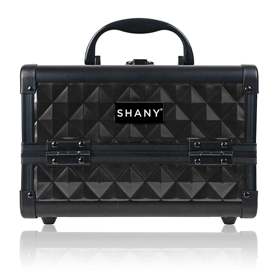 "<h3><strong>SHANY Mini Makeup Train Case With Mirror</strong></h3><br><strong>The Rock Star Worthy Makeup Organizer</strong><br><br>Come for this mini train case's studded exterior, stay for the storage space and portability. (Oh, and it comes in a rainbow of colors.)<br><br><strong>The Hype: </strong>4.3 out of 5 stars and 1,544 reviews on <a href=""https://amzn.to/3j9kao9"" rel=""nofollow noopener"" target=""_blank"" data-ylk=""slk:Amazon"" class=""link rapid-noclick-resp"">Amazon</a><br><br><strong>Organization Obsessives Say: </strong>""This train case was much bigger than I thought. I fit about all of my make-up including my full size brushes in this tiny case. I usually carry a large box and two small bags I'm excited to have such a great organized make-up case. I was impressed in the quality of this case. The only flaw in this is the second tray doesn't seem to hold my double eye shadow, but I'm perfectly fine with that because it fits great in the bottom with my brushes and other larger items. I'm very pleased with this case. My fiance calls it my tool box. It's a great buy.."" — Amber Maddux, Amazon Reviewer<br><br><strong>SHANY</strong> Mini Makeup Train Case With Mirror, $, available at <a href=""https://www.amazon.com/SHANY-Mini-Makeup-Train-Mirror/dp/B00JGN2DZW/ref=sr_1_21_sspa"" rel=""nofollow noopener"" target=""_blank"" data-ylk=""slk:Amazon"" class=""link rapid-noclick-resp"">Amazon</a>"