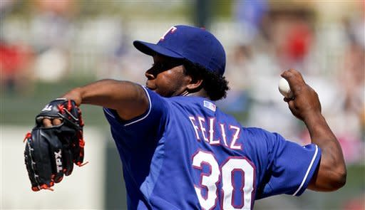 Texas Rangers pitcher Neftali Feliz works the first inning against the Colorado Rockies in a spring training baseball game on Wednesday, March 14, 2012, in Surprise, Ariz. The Rangers are trying to convert Feliz, who was their closer, into a starter. (AP Photo/Lenny Ignelzi)