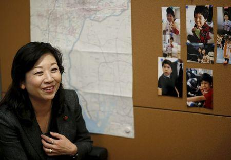 Seiko Noda, a former cabinet minister and Liberal Democratic Party (LDP) policy chief, speaks next to photos of her son during an interview with Reuters at her office in Tokyo, Japan, December 21, 2015. REUTERS/Toru Hanai