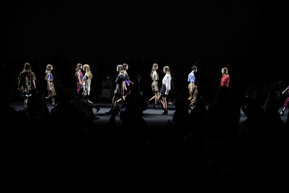 Models wear creations part of the Shi.RT women's Spring-Summer 2021 ready-to-wear collection, that was presented in Milan, Italy, Sunday, Sept. 27, 2020. (AP Photo/Luca Bruno).