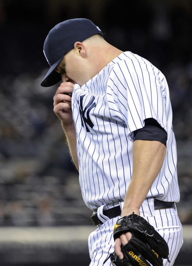 New York Yankees pitcher Shawn Kelley reacts after allowing the Baltimore Orioles to score two runs during the ninth inning of a baseball game Wednesday, April 9, 2014, at Yankee Stadium in New York. The Orioles won 5-4. (AP Photo/Bill Kostroun)