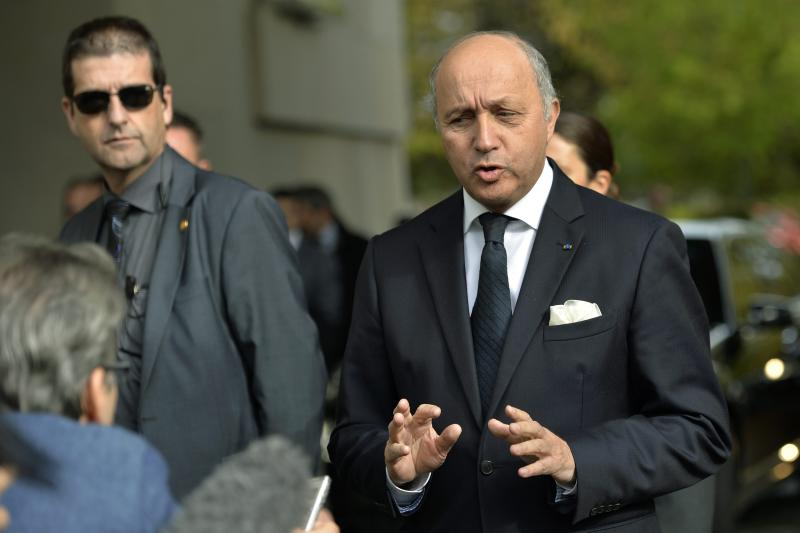 "French foreign minister Laurent Fabius arrives for the second day of closed-door nuclear talks at the United Nations offices in Geneva, Switzerland, Friday, Nov. 8, 2013. Four world powers are dispatching their top diplomats to Geneva on Friday to add their weight to negotiations aimed at putting initial limits on Iran's ability to make atomic weapons. French, British and German foreign ministers are joining U.S. Secretary of State John Kerry in Geneva, who will be coming ""to help narrow differences in negotiations,"" according to a U.S. official who spoke on condition of anonymity because he was not authorized to release the information. (AP Photo/Martial Trezzini, Pool)"