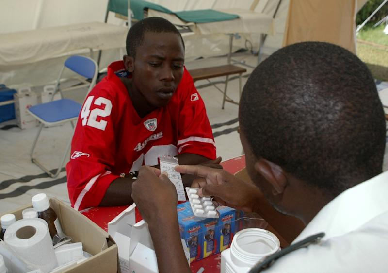 A patient receives medication for typhoid at the Kuwadzana clinic in Kuwadzana township, on the outskirts of Harare, in 2012