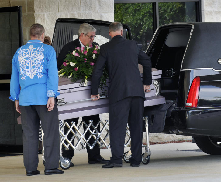 The casket of 8-year-old Cherish Perrywinkle is brought in before a viewing at Paxon Revival Center Church on Thursday, June 27, 2013 in Jacksonville, Fla. Cherish, who police say was targeted by a registered sex offender, was abducted and killed last Friday. (AP Photo/The Florida Times-Union, Will Dickey)
