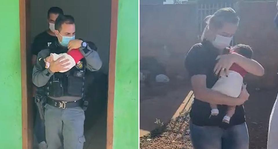 Brazilian authorities holding a baby who was rescued from an alleged drug den.