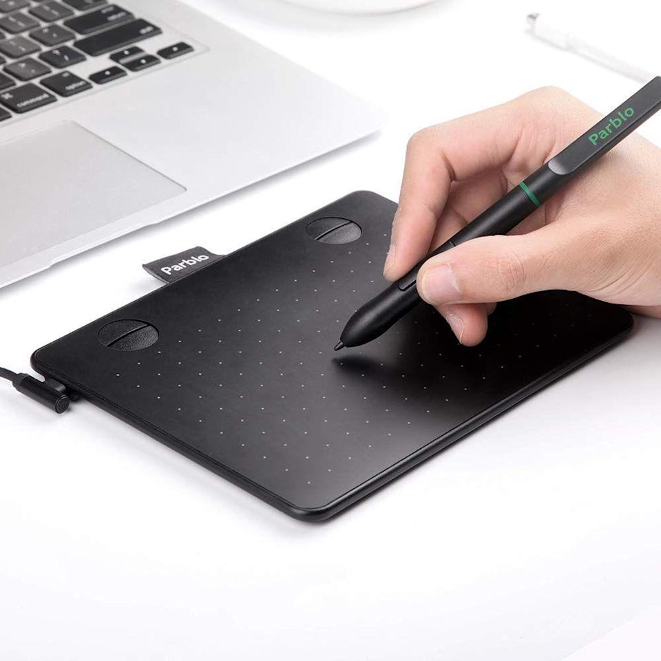 """<h3>The Art-Lovin' Dad</h3><p>Watch as your dad's inner artist breaks out with a graphic drawing tablet plugs directly into his laptop. Gone are the days of splotchy creations on Microsoft Paint — now he can skillfully draw, sketch, paint, and easily erase the mishaps on any of his creative feats.</p><br><br><strong>Parblo</strong> A640 Drawing Tablet, $29.99, available at <a href=""""https://www.amazon.com/dp/B07KT49WT2"""" rel=""""nofollow noopener"""" target=""""_blank"""" data-ylk=""""slk:Amazon"""" class=""""link rapid-noclick-resp"""">Amazon</a>"""
