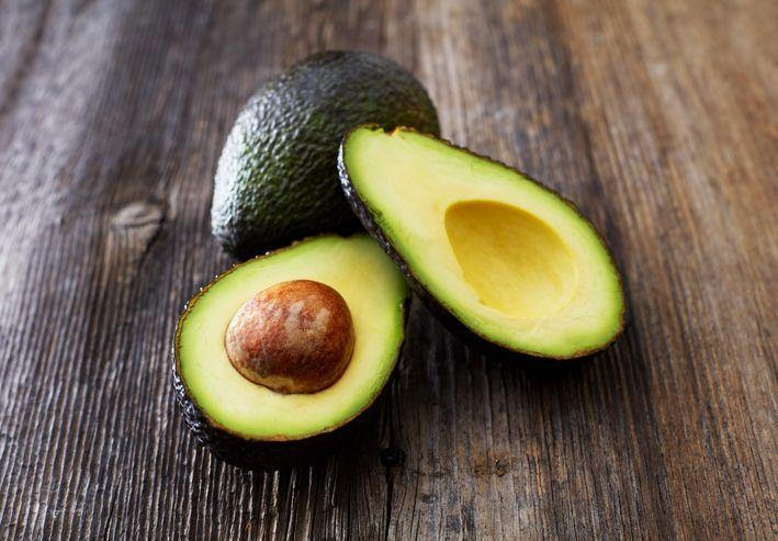 """<p>Packed with healthy fats, avocados can help keep your skin plump, <a href=""""https://www.prevention.com/food-nutrition/g20474000/7-foods-that-stop-hair-loss/"""" rel=""""nofollow noopener"""" target=""""_blank"""" data-ylk=""""slk:nourish your hair"""" class=""""link rapid-noclick-resp"""">nourish your hair</a>, and help <a href=""""https://www.prevention.com/health/health-conditions/g26576559/foods-for-high-blood-pressure/"""" rel=""""nofollow noopener"""" target=""""_blank"""" data-ylk=""""slk:lower blood pressure"""" class=""""link rapid-noclick-resp"""">lower blood pressure</a>, thanks to their decent <a href=""""https://www.prevention.com/food-nutrition/a20466110/13-foods-that-have-more-potassium-than-a-banana/"""" rel=""""nofollow noopener"""" target=""""_blank"""" data-ylk=""""slk:potassium"""" class=""""link rapid-noclick-resp"""">potassium</a> content. """"Although avocados are very high in fat, they are linked with weight loss because they are so satisfying,"""" says Mirkin.<br></p><p><strong>Try it:</strong> <a href=""""https://www.prevention.com/food-nutrition/recipes/a26986140/shrimp-avocado-and-egg-chopped-salad-recipe/"""" rel=""""nofollow noopener"""" target=""""_blank"""" data-ylk=""""slk:Shrimp, Avocado, and Egg Chopped Salad"""" class=""""link rapid-noclick-resp"""">Shrimp, Avocado, and Egg Chopped Salad</a> from <a href=""""https://www.amazon.com/Fill-Your-Plate-Lose-Weight/dp/1950099008/ref=sr_1_2?tag=syn-yahoo-20&ascsubtag=%5Bartid%7C10070.g.35366101%5Bsrc%7Cyahoo-us"""" rel=""""nofollow noopener"""" target=""""_blank"""" data-ylk=""""slk:Fill Your Plate, Lose The Weight"""" class=""""link rapid-noclick-resp""""><em>Fill Your Plate, Lose The Weight</em></a></p>"""